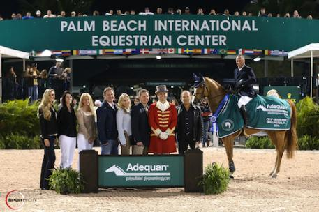 Todd Minikus and Babalou 41 in their winning presentation with (left to right) Audrey Bolte, Associate Brand Manager for Luitpold Animal Health, Caroline Hogan, Kathy Serio, Senior Territory Manager for Luitpold Animal Health, Equestrian Sport Productions CEO Mark Bellissimo, Wellington Equestrian Partners principal Katherine Bellissimo, Allyn Mann, Director, Luitpold Animal Health, ringmaster Christian Craig, and Babalou 41's owner Enrique Cadena.