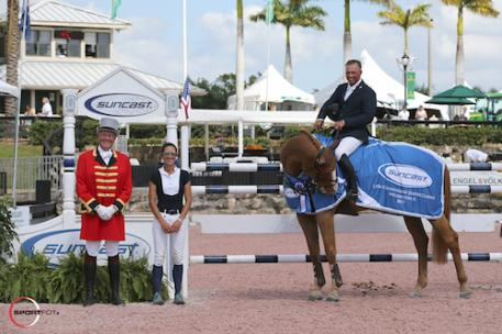 Todd Minikus and Zephyr in their winning presentation with  ringmaster Steve Rector and Lauren Tisbo of Suncast®.