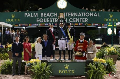 McLain Ward, Sergio Alvarez Moya, and Karen Polle on the podium with (L to R): Joël Aeschlimann, Head of Sponsorship, Rolex; Anne Pradal-Carrega, Communication & Image - Sponsorship, Rolex; Katherine and Mark Bellissimo of Equestrian Sport Productions; ringmaster Steve Rector; and Marsha Dammerman of Wellington Equestrian Partners presenting The Dennis Dammerman Perpetual Trophy.