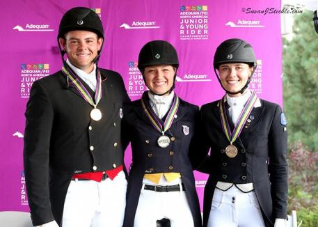 Nicholas Hansen, Rebekah Mingari, and Emily Ferguson after their medal presentation ceremony.