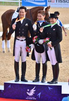 The Individual Dressage medals at the 2014 Asian Games went to Dong Seon Kim (Silver), Young-shik Hwang (Gold), and Larasati Iris Rischka Gading (Bronze). (Photo: HorseMoveThailand)