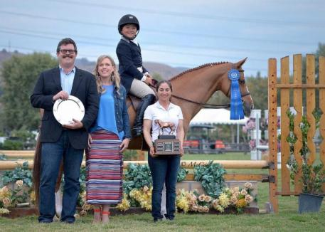 Augusta Iwasaki and Kingston with Brandon Seger of Markel Insurance, Melissa Brandes of Blenheim EquiSports and Karen Perlow presenting the Just a Minute Perpetual Trophy (Photo: McCool)