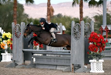 Augusta Iwasaki and Somekindawonderful jump to victory in the ,000 Pony Hunter Classic at HITS Desert Circuit III on Friday, January 30, 2015. (c) ESI Photography