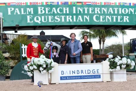 GumBits creator Shereen Fuqua, her husband Jeff, and daughter Kat are active in the equestrian world (from left to right: Kat Fuqua, Shereen Fuqua, Jeff Fuqua, and Elise Fraza) (Photo courtesy of Anne Gittins Photography)