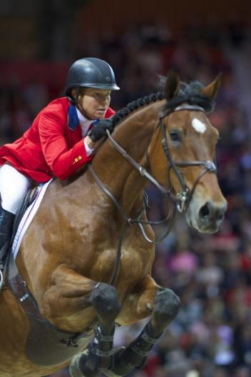 2013 FEI World Cup champions Beezie Madden (USA) and Simon (c) Arnd Bronkhorst / FEI