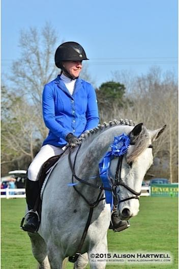 Bryn Sandler looks good in blue as she waits to take her victory gallop around the grand prix field.