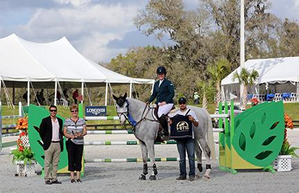 Cara Raether and Lyonell, owned by Trelawny Farm LLC, won the blue in the $25,000 SmartPark Grand Prix, held Thursday, March 5, 2015, at HITS Ocala. (c) ESI Photography