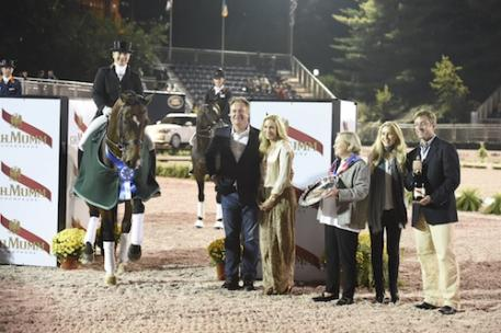 Isabell Werth and El Santo NRW in their winning presentation with Mark and Katherine Bellissimo, Tammany Patrick of Axel Johnson Group, Paige Bellissimo, and Jim Wolf. Photo Credit Kit Houghton/Rolex
