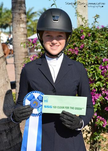 "Daisy Farish proudly displays her ,000 bonus won in the SSG Gloves ""Go Clean for the Green"" promotion. Photo by Starting Gate Communications"