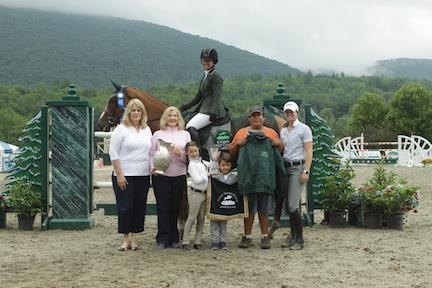Following their win in the $30,000 Otter Creek Grand Prix at the Vermont Summer Festival, Danielle Torano and Callas 2 are joined by members of the JET Show Stables Team, including groom Gerardo Briseno. (Photo: David Mullinix Photography)