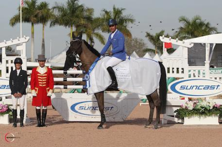 Doda de Miranda and AD Argos in their winning presentation with Lauren Tisbo of Suncast® and ringmaster Gustavo Murcia. Photo © Sportfot, An Official Photographer of the Winter Equestrian Festival, us.sportfot.com