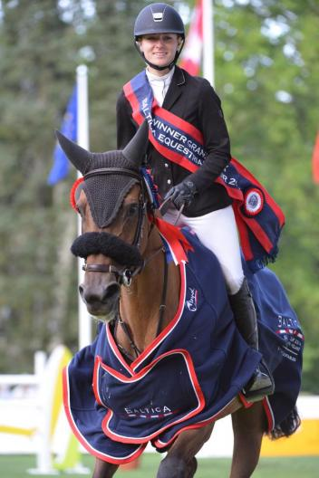 Dzavik and Delphine take the victory gallop after winning the CSI** Grand Prix in Chokzewo, Poland