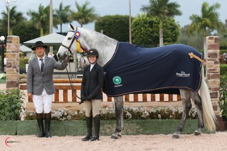 Emma Kurtz and Graffito in their championship presentation with ringmaster Gustavo Murcia. Photo © Sportfot, An Official Photographer of the Winter Equestrian Festival, us.sportfot.com.