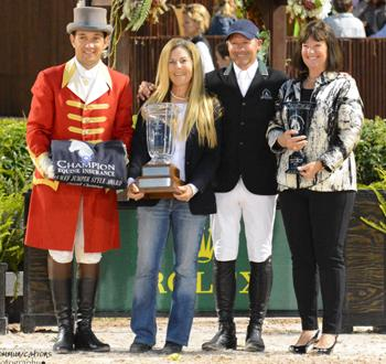Laura Fetterman of Champion Equine Insurance, accompanied by ringmaster Gustavo Murcia, presents rider Eric Lamaze and owner Carlene Ziegler of Artisan Farms with the Champion Equine Insurance Overall Jumper Style Award for Fine Lady 5. Photo by Starting Gate Communications