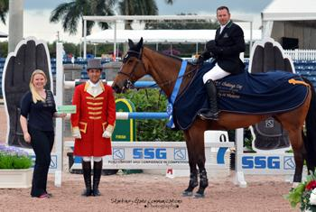 Eric Lamaze and Rosana du Park are presented as the winners of the $30,000 Ruby et Violette WEF Challenge Cup Round II and the $3,000 SSG Gloves bonus by Jennifer Ward and ringmaster Gustavo Murcia. Photo by Starting Gate Communications