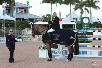 "Eric Lamaze is presented with a $3,000 bonus from Jennifer Ward in the SSG Gloves ""Go Clean for the Green"" promotion, bringing his total bonus money won to date to 2,000. Photo by Sportfot"