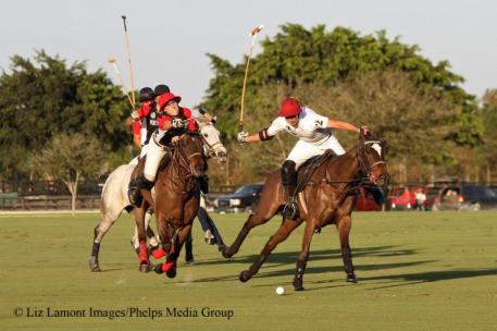 Facundo Obregon reaches for the hook on Augustin Obregon. Photo: Liz Lamont Images/Phelps Media Group.