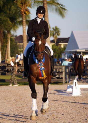 Faye Flynn of Eustis, Florida qualified at both First Level and First Level Freestyle (AA division) with her own 9-year-old Oldenburg gelding Rosevelt, winning her USDF Region 3 Championships class with a 78%.