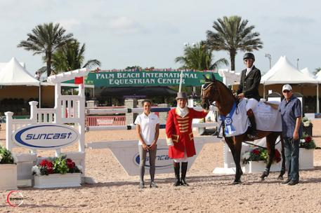 Fernando Cardenas and Quincy Car in their winning presentation with Lauren Tisbo of Suncast®. Photo © Sportfot, An Official Photographer of the Winter Equestrian Festival, us.sportfot.com.