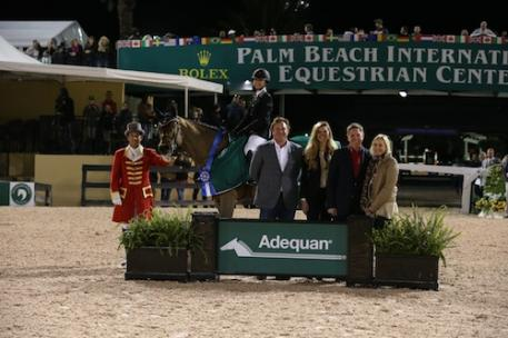 Georgina Bloomberg and Lilli in their winning presentation with ringmaster Gustavo Murcia; Equestrian Sport Productions' CEO Mark Bellissimo; Audrey Bolte, Adequan® Brand Manager; Allyn Mann, Director of the Animal Health Division at Luitpold Pharmaceuticals, Inc; and Katherine Bellissimo, WEP Principal. Photo © Sportfot, An Official Photographer of the Winter Equestrian Festival, us.sportfot.com.