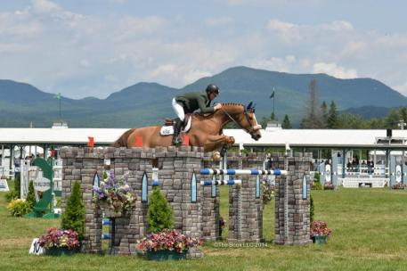 Jeff Welles rode Prem Dollar Boy to victory in the $75,000 Devoucoux Grand Prix of Lake Placid to culminate the 2014 Lake Placid Horse Show.