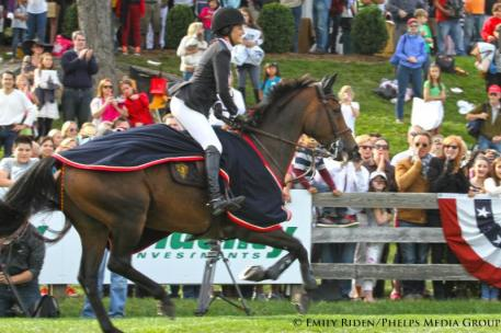 Jessica Springsteen leads the victory gallop in front of the crowd that includes her parents, Bruce Springsteen and Patti Scialfa (pictured bottom right)