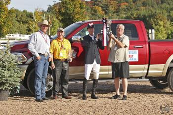 Ian Millar is presented as the winner of the RAM Caledon Caledon Cup, having won Phase I with Star Power and placed second in Phase II riding Dixson. Photo by Ben Radvanyi Photography