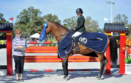 Kaitlin Campbell and her Rocky W get the blue ribbon in the $25,000 SmartPak Grand Prix at HITS Ocala. (c) ESI Photography