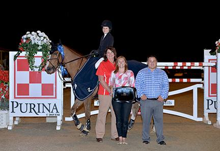 Katherine Dinan and Nougat Du Vallet, owned by Grand Road Partners, win the blue ribbon in the $50,000 Purina Animal Nutrition Grand Prix CSI2*-W Saturday night at HITS Thermal. (c) ESI Photography