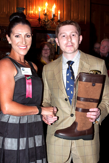 Danny Hulse (right) presents the Dubarry boots to Laine Ashker. (Michelle Dunn photo)