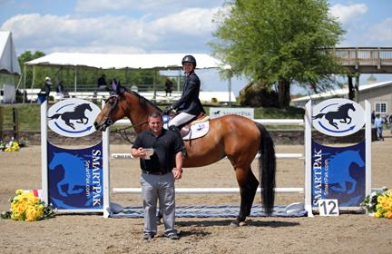Laura Chapot and ISHD Dual Star, owned by Mary Chapot, claim the blue ribbon in the $25,000 SmartPak Grand Prix at HITS-on-the-Hudson I on May 22, 2015. (c) ESI Photography
