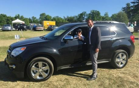 Margie Engle, the Leading Athlete at the Split Rock Jumping Tour, gets the keys to her brand new Chevy Equinox from Split Rock Jumping Tour Founder and President Derek Braun