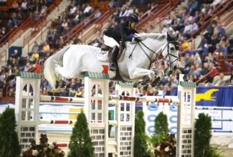 Margie Engle riding Indigo in her Equine Couture Stars & Stripes Breeches at the Pennsylvania National Horse Show.