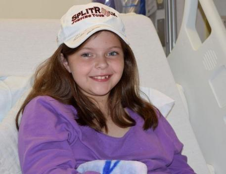 Marlee Powell wearing her autographed SRJT hat (Photos: McFarland/EqSol)
