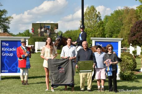Mclain Ward and HH Carlos Z accept winner's awards from Kamran and Ellen Hakim and grandson,with sponsors Nicole and Christopher Kincade, and Ringmaster John Franzreb. Photo by The Book, LLC