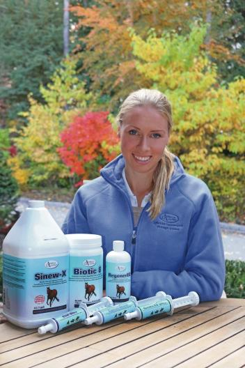 Winning Grand Prix dressage rider Megan Lane with some of her favorite Omega Alpha products (Photo: Brenda Snape)