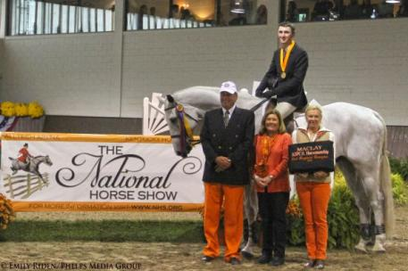 Michael Hughes accepts his award for the win, presented on behalf of the National Horse Show.