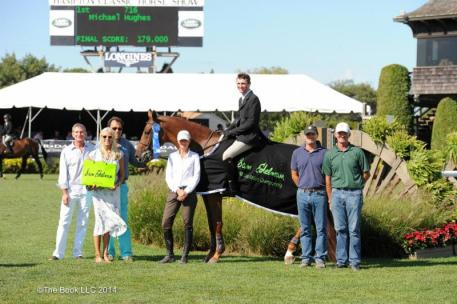 Michael Hughes won the Sam Edelman Equitation Championship. Photo by: The Book LLC 2014