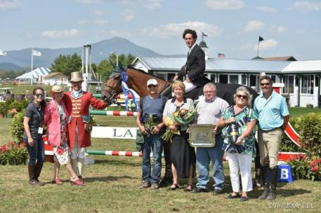 Nick Dello Joio receives his awards following his win (Photo: The Book LLC)