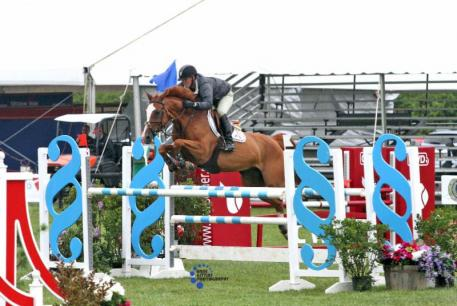 Peter Leone and Jewel's Exclusive Touch win top honors in the 1.30m jumpers. Photo by Anne Gittins