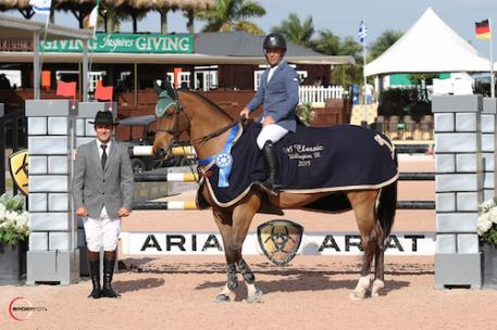 Ronan McGuigan and Capall Zidane in their winning presentation with ringmaster Gustavo Murcia. Photo Credit: Photos © Sportfot, An Official Photographer of the Winter Equestrian Festival, us.sportfot.com.