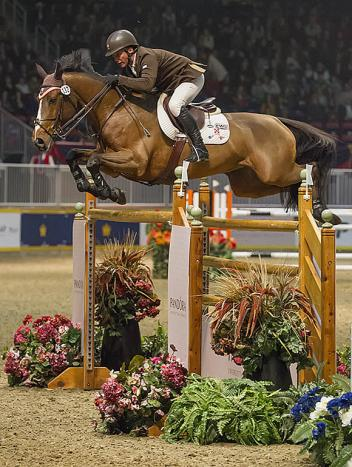 Loxahatchee, Florida's Todd Minikus and Quality Girl held on to second in the 00,000 Hickstead FEI World CupTM Grand Prix, Presented by Hudson's Bay, tonight, at the CSI4*-W Toronto, the Royal Horse Show. Photo: BenRadvanyi.com