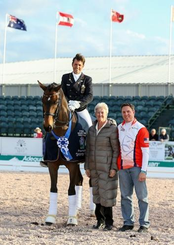 "Christoph and ""Rusty"" in their winning presentation with judge Lilo Fore and Allyn Mann"