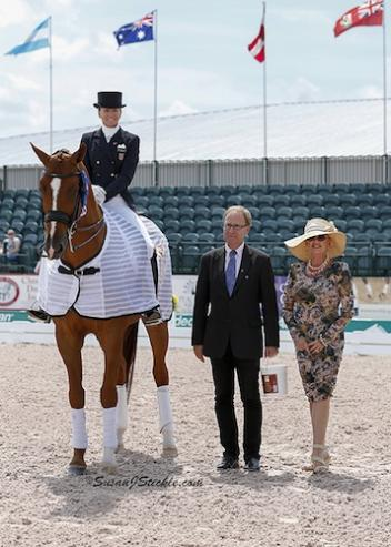 Lisa and Galant in their winning presentation with judge Bo Jena and Meryl Squires of Regal Horse Products.