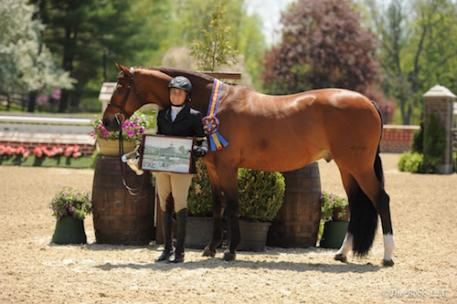 Victoria Colvin and Ovation in their winner's presentation. Photo by The Book, LLC