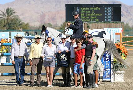 Will Simpson and Katie Riddle, owned by Monarch International, take home the blue ribbon in Friday's $25,000 SmartPak Wild Card Grand Prix at HITS Thermal. (c) ESI Photography