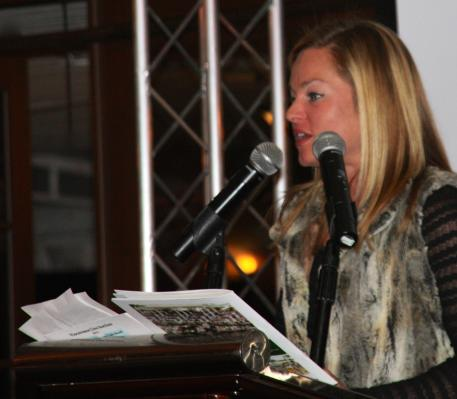 Devon Kane, Chairperson of the Young Professional Committee for the Vinceremos Therapeutic Riding Center, speaks at the Vinceremos Therapeutic Riding Center's Annual Auction and Dinner