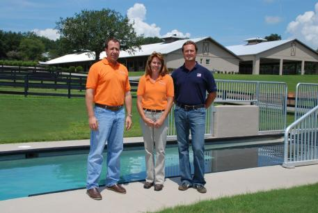 "Tom Grabe, The Sanctuary's Managing Partner and Brenda McDuffee, General Manager ""horse"" poolside at the Sanctuary with Chester Weber. (Photo courtesy of the Equine Chronicle)"
