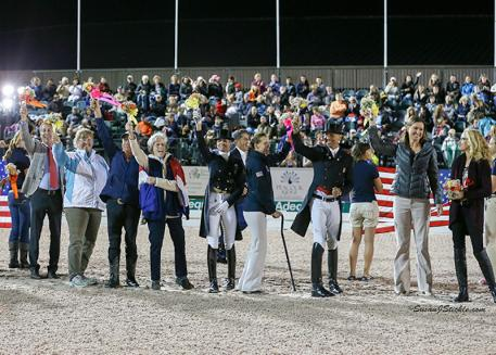 During the Olympian Salute before the CDI5* Grand Prix Freestyle Friday Night Under the Lights at the Adequan Global Dressage Festival, Diamante Farms presented thirty Olympians from eight countries with flowers (Photo: Susan J Stickle)