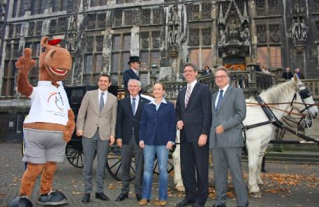"Right to left: Frank Kemperman, Marcel Philipp, Isabell Werth, Carl Meulenbergh, Michael Mronz and the CHIO mascot ""Karli""."